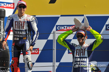 Podium: race winner Valentino Rossi, Fiat Yamaha Team with his donkey hat, and second place Jorge Lorenzo, Fiat Yamaha Team