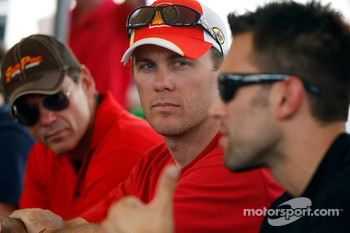 From left, Ray Evernham, Kevin Harvick and Aric Almirola talk during the driver's meeting