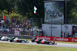 Lewis Hamilton, McLaren Mercedes leads Kimi Raikkonen, Scuderia Ferrari at the start of the race