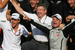 Race winner Rubens Barrichello, Brawn GP, celebrates with Jenson Button, BrawnGP, Ross Brawn, Brawn GP, Team Principal, and BrawnGP team members