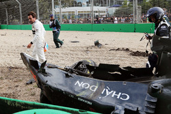 Fernando Alonso, looks at his McLaren MP4-31 after his race stopping crash
