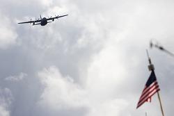 A C-130 aircraft flyover