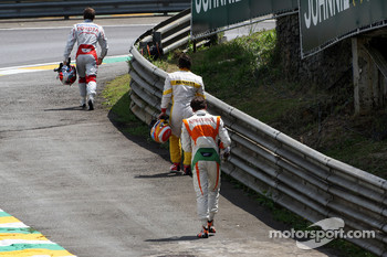 Jarno Trulli, Toyota F1 Team, Fernando Alonso, Renault F1 Team and Adrian Sutil, Force India F1 Team, walk back to the pits after an incident on the first lap