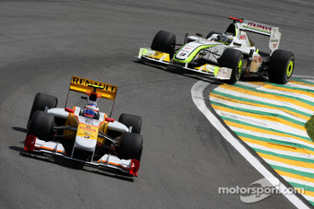 Romain Grosjean, Renault F1 Team leads Jenson Button, BrawnGP