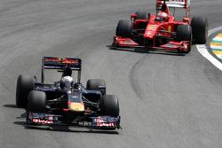 Jaime Alguersuari, Scuderia Toro Rosso leads Kimi Raikkonen, Scuderia Ferrari
