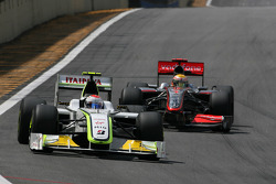 Rubens Barrichello, Brawn GP and Lewis Hamilton, McLaren Mercedes