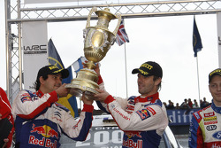 Podium: winners and 2009 WRC champions Sébastien Loeb and Daniel Elena