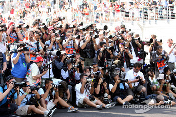 Photographers at work during the drivers group picture