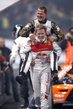 Race of Champions winner Mattias Ekstrm celebrates with Michael Schumacher