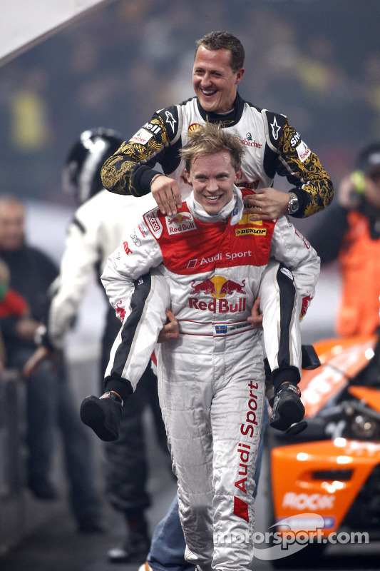 Race of Champions winner Mattias Ekström celebrates with Michael Schumacher