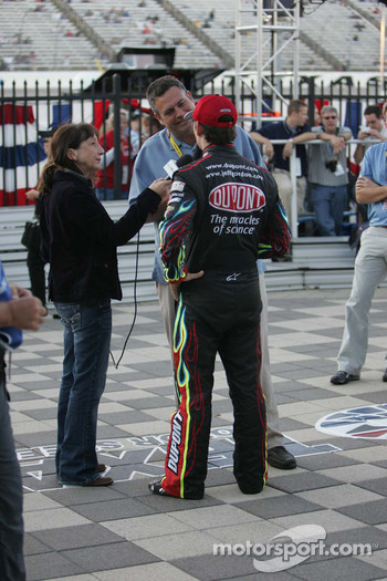 Pole winner Jeff Gordon does radio interviews in Victory Lane