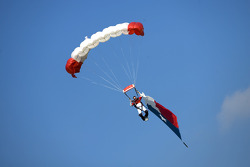A skydiver with the Texas flag
