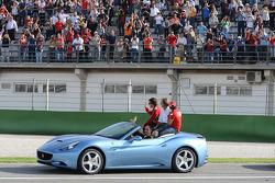 A backup Ferrari California picks up Luca di Montezemolo, Felipe Massa and Fernando Alonso for the drive around the track