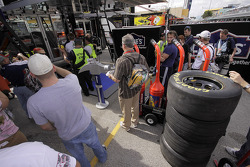 Fans and media crowd around Jimmie Johnson's hauler
