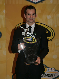 Jeff Gordon with his award for third place in the Chase for the NASCAR Sprint Cup