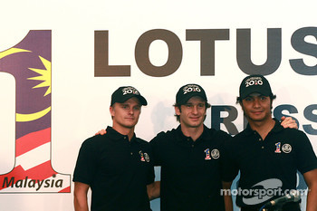 The newly-announced drivers for the Malaysian-backed Lotus F1 team: Jarno Trulli, Heikki Kovalainen and Fairuz Fauzi, post for photograph during the team drivers announcement  press conference in Kuala Lumpur
