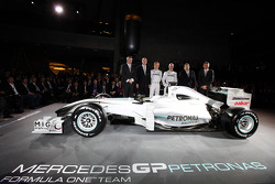 Ross Brawn, Dr. Dieter Zetsche, Nico Rosberg, Michael Schumacher, Norbert Haug and  Nick Fry pose with the 2009 Brawn GP car with the 2010 livery