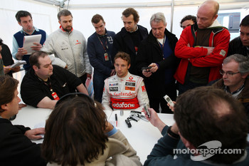 Jenson Button, McLaren Mercedes, talks to the media