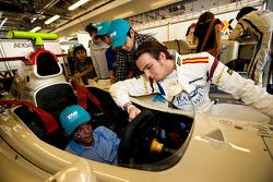 Giedo Van der Garde meets local Children visiting the GP2 Paddock