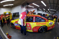 Richard Childress Racing Chevrolet crew members work on the car of Kevin Harvick