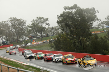 The race is stopped and the cars are parked at the top of the Mountan after a tree comes down over the track