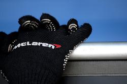 The gloves of a Mclaren mechanic