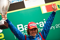 Charles Pic celebrates victory on the podium