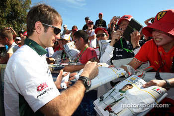 Jarno Trulli, Lotus F1 Team, signs autographs