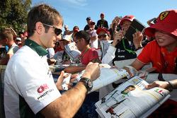 Jarno Trulli, Lotus F1 Team, signs autographs