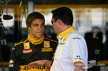 Vitaly Petrov, Renault F1 Team with Eric Boullier, Team Principal, Renault F1 Team