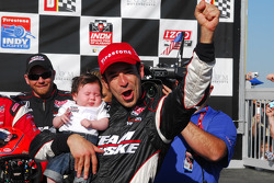 Race winner Helio Castroneves in victory lane hold his daughter