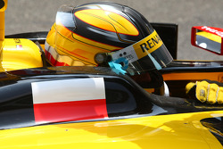 Robert Kubica, Renault F1 Team with a large Polish flag on the side of the car