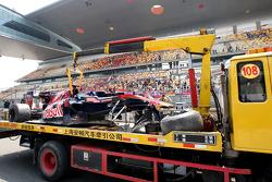 The damaged car of Sebastien Buemi, Scuderia Toro Rosso is returned to the pits