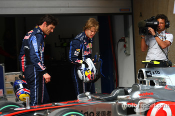 Mark Webber, Red Bull Racing and Sebastian Vettel, Red Bull Racing take a look at the McLaren