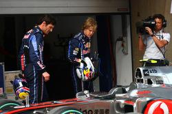 Mark Webber, Red Bull Racing and Sebastian Vettel, Red Bull Racing take a look at the McLaren