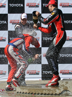 Ryan Hunter-Reay, Will Power and Justin Wilson spray the champagne