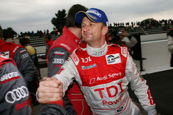 Race winner Allan McNish celebrates