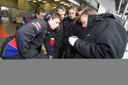 Team Oreca Matmut team members practice tire change