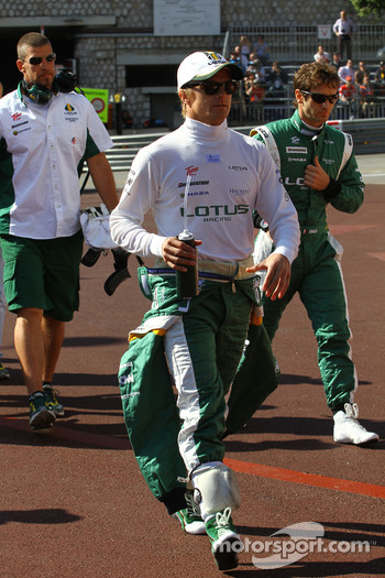 Heikki Kovalainen, Lotus F1 Team and Jarno Trulli, Lotus F1 Team