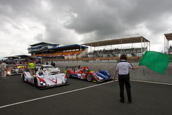 Race director Daniel Poissenot drops the green flag to start the first session