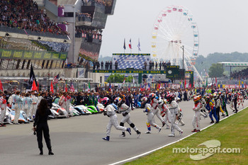 Drivers race to their cars in the traditional manner