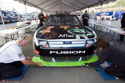 The No. 99 Aflac Ford goes through inspection