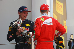 Race winner Max Verstappen, Red Bull Racing celebrates on the podium with third placed Sebastian Vettel, Ferrari