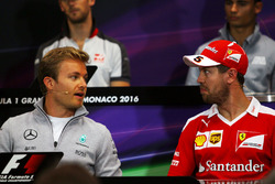 Nico Rosberg, Mercedes AMG F1 and Sebastian Vettel, Ferrari in the FIA Press Conference