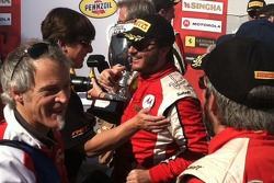 Happy smiles from Carlos in Victory Lane