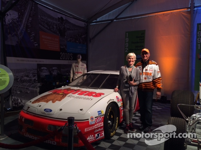 Ellie & Mike Cesario proudly pose in Memory Lane next to their #7 Alan Kulwicki Hooters Thunderbird