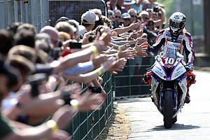 Road racing Race report Isle of Man TT: Hickman wins thriller, smashes lap record