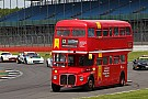 Automotive British double-decker bus turns laps with race cars at Silverstone