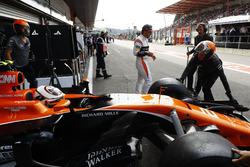 Stoffel Vandoorne, McLaren, is backed in to the garage as Fernando Alonso, McLaren, walks past