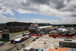 A scenic view of the Barcelona paddock, pit building and pit straight grandstand
